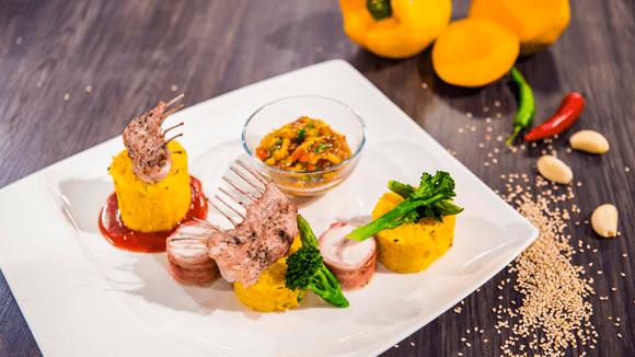 Pistachio Crusted Rabbit with Herb Polenta, Raw Mango Salsa and Cranberry image