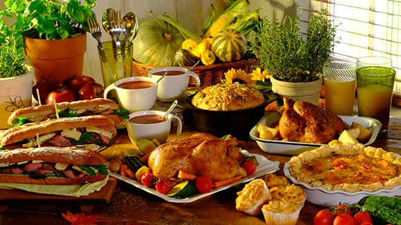 Table filled with various delicious meals